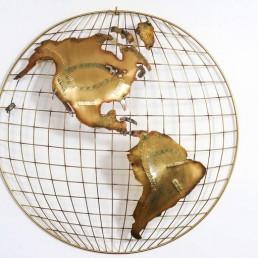 The World brass wall sculptures by Curtis Jeré