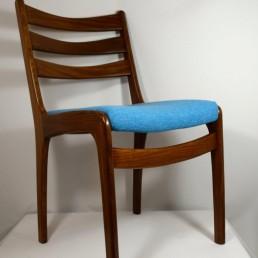 four Scandinavian teak dining chairs