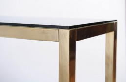 Detail Hollywood regency etagère in shiny brass and smoked glass by Renato Zevi