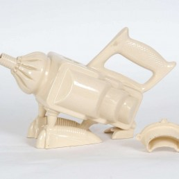 Porcelain teapot in postmodern style with a saw handle