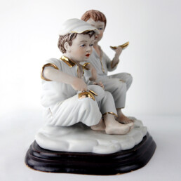 Biscuit Porcelain Statuette of Two Boys Eating a Melon with Gold-Colored Details